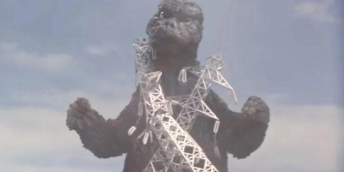 Godzilla with metal towers sticking to him