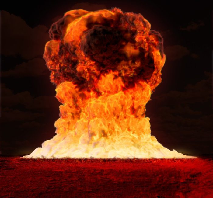 A gigantic fireball of a nuclear bomb explosion.