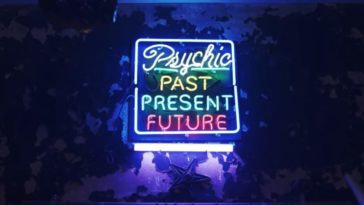"""A neon sign eerily lit says """"Psychic: Past, Present, Future"""