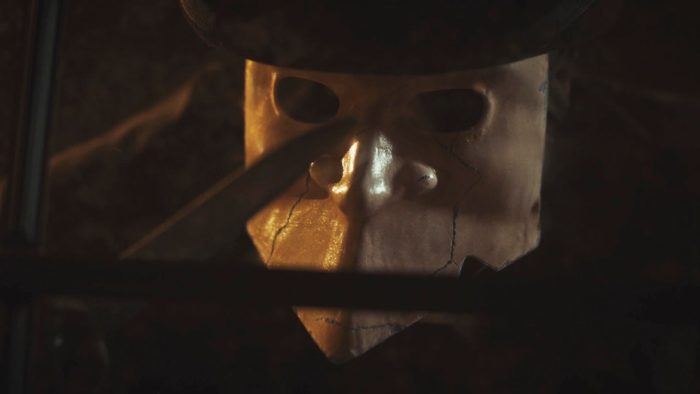 The masked killer looks into the window after Liv escapes their wrath