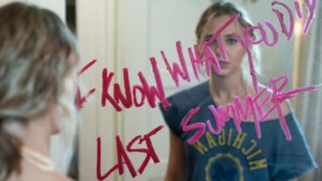 """Lennon stands in front of her mirror, it reads """"I Know What You Did Last Summer"""""""