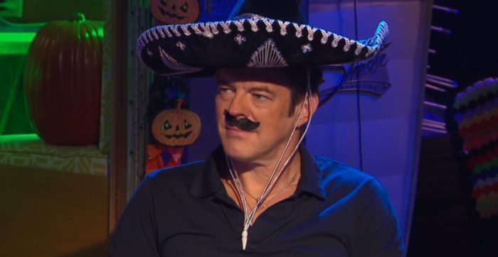 Jason Blum wearing a sombrero and fake moustache during Joe Bob's Halloween Hoedown