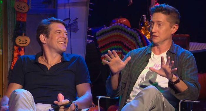 Jason Blum and David Gordon Green sitting and talking during Joe Bob's Halloween Hoedown