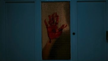 A bloody hand on a pane of glass in Lair