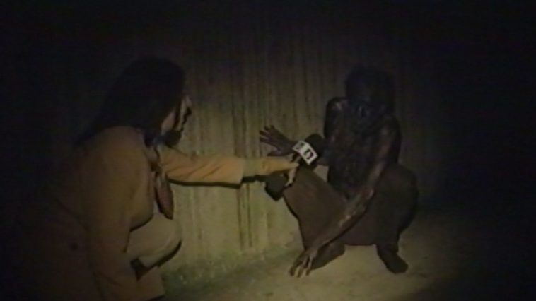 The reported kneels down to talk to someone she met in the sewer, while looking for Ratman