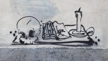 An ink drawing of a skull, book, and candle.