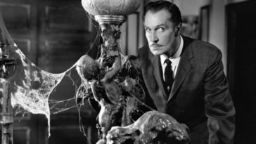 Vincent Price in House on Haunted Hill (1959), looking suspicious while surrounded by furniture laden with cobwebs